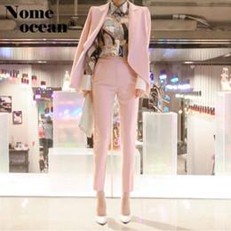 Anzug schief online-Art- und Weisefrauenklage-Jacke und Hosen-zwei Stück-formale Klage-Schulter-schräge Knopf-Blazer-Anzüge dünnes OL passt M18050704