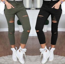 Nuevo 2016 Skinny Jeans Mujer Pantalones de mezclilla Agujeros Destruidos Rodilla Lápiz Pantalones Pantalones Casual Negro Blanco Stretch Ripped Jeans desde fabricantes