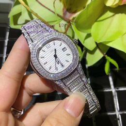 Montres de luxe suisse diamant en Ligne-Montres de luxe pour femmes Hommes Montres suisses Ronda Quartz 515 Mouvement pavé de diamants Bracelet Eta Nautilus 33mm Montre-bracelet pour femme