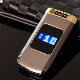 Teléfonos celulares con pantalla táctil grande online-Flip de lujo 2.4 pulgadas Pantalla táctil doble Cuerpo de metal Tarjeta SIM dual MP3 FM Teléfono celular dorado Letra de teclado grande Diseño de moda teléfono celular móvil