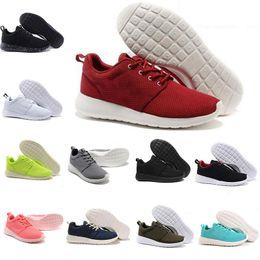 buy online 953b4 c5a06 TANJUN KAISHI Triple Noir Blanc Rose London Olympique Pistes En Plein Air  Hommes Femmes Classique Sports Running Chaussures De Mode Formateur  Designer ...