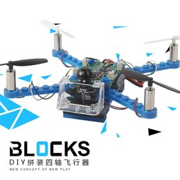 Wholesale mini helicopter batteries - Wholesale- DIY Block Drones 2.4G Building Blocks Mini Drone with No Camera Assembling Bricks Helicopter For Child
