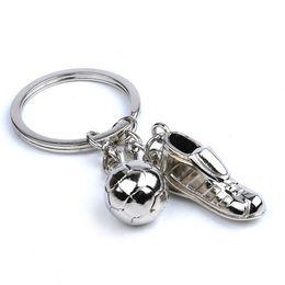 Fußballschuhball online-Art und Weise 50pcs heiße verkaufende einzigartige Fußball-Schuhe Fußball-Ball-Edelstahl-Metall-Schlüsselanhänger Schlüsselanhänger Ring-Geschenk für Events Parties usw.