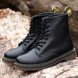 Argentina Botas de cuero más nuevas Estilo de tobillo de invierno Botas de cuero genuino Zapatos Hombres Diseñador de mujer Botas impermeables Suministro