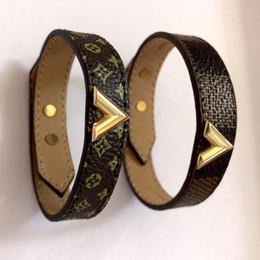 Wholesale fine jewelry brands - New style Titanium steel genuine leather bracelets with gold V shape design for women and men flower pattern bracelet brand fine jewelry