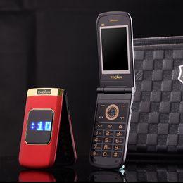 Teléfonos celulares con pantalla táctil grande online-Flip de lujo 2.4 pulgadas Pantalla táctil doble Cuerpo de metal Tarjeta SIM dual MP3 FM Teléfono celular dorado Letra grande del teclado altavoz fuerte teléfono celular móvil