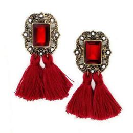 Belles boucles d'oreilles pendantes élégantes de style BOHO style long pompon pour les femmes ? partir de fabricateur