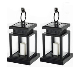 Wholesale outdoor candles lanterns - Solar Lantern Candle Hanging Lights Outdoor White Warm White Candle Flicker Auto Sensor On Off Solar Garden Lights for Patio Landscape Yard