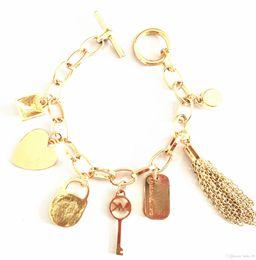 Wholesale Gold Bracelets For Men - 2018 Luxury big brand bracelet MK Solid Color Punk Tassel Multi-pendant bracelet for Men and Women