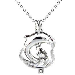 Medallón grande de plata online-Silver Ocean Animal Large Dolphin Hollow Oil Difusor Locket Mujeres Aromatherapy Beads Pearl Oyster Jaula Collar Colgante-Boutique regalo