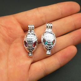 En 2018, el nuevo diseño es brillante plata araña hombre perla jaula 10pcs joyería que hace perla jaula colgante esencia aceite difusor perla perla. desde fabricantes