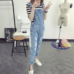 d2a83222a39 Korean Style Summer Denim Jumpsuits 2017 Fashion Women s Overalls Female  Hole Preppy Style Loose Slim Denim Strap Trousers