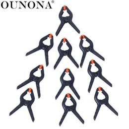 Fotos da lona on-line-OUNONA 16pcs 45 milímetros Photo Studio Canvas Musselina Paperdrop Clamp Clips (preto + laranja)