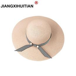 Verano perlas sombrero de paja de las mujeres grandes de ala ancha sombrero  de playa sol plegable bloqueador solar protección UV panama hueso chapeu ... e6af20ce361
