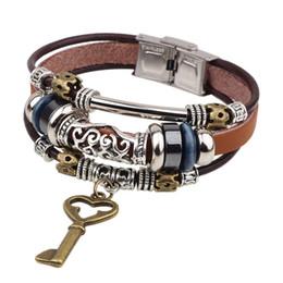 2019 bracelet style rue Nouveau Style Rétro Créativité Personnalité Bracelet Haute Qualité En Cuir Amour Or Clé Clé Couple Marron Bijoux Rue Tir Cadeaux promotion bracelet style rue