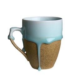 Tazze di ceramica di flusso di ceramica blu fatte a mano creative Tazze di porcellana rotonde / irregolari Tazze di caffè di caffè bianco / marrone cheap white porcelain coffee cup da tazza di caffè bianco della porcellana fornitori