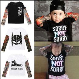 32fb935f1ba9 Boys Girls Tattoo Sleeve T shirt Children Kids Clothes Boys T shirt  Splicing Body Art Hip hop Clothing for kids KKA4801