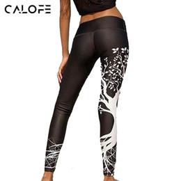2019 leggings arbol estampado CALOFE Skinny Push Up Leggin Mujeres Pantalones de yoga Funny Tree Print Leggings Entrenamiento Gym Medias Blanco Negro Pantalones deportivos de jogging leggings arbol estampado baratos