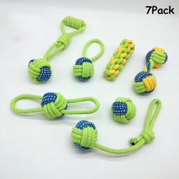Pequenos cachorros de brinquedo on-line-7 pcs filhotes de cachorro de brinquedo de corda de algodão mastigar dente de algodão de limpeza corda com alça bola para pequenos cães de médio porte