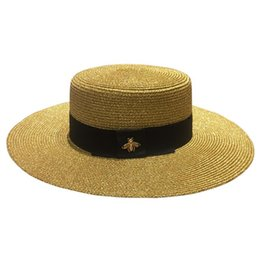 Wholesale Grass Shades - 2018 new summer retro golden weave straw hat bee woman fashion wide sunscreen travel sun shade flat top hat M00015