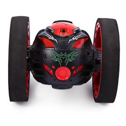 2019 führte bouncing lichter Neue design mini geschenke hüpfburg sj88 2,4 ghz rc hüpfburg mit flexiblen rädern drehung led licht fernbedienung roboter auto günstig führte bouncing lichter