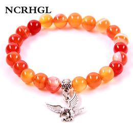 2019 pietre arancioni NCRHGL New Orange Onyx pietra naturale 8 MM borda il braccialetto EAGLE braccialetti con perline di fascino presenti in gioielli per le donne uomini 7choosed pietre arancioni economici