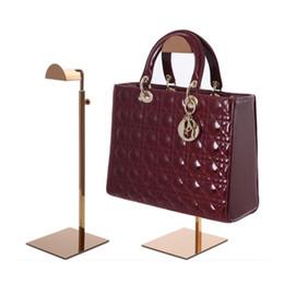 handtasche zeigt stand Rabatt Schwarzes / rosafarbenes Goldmetallhandtaschen-Ausstellungsstand justierbare Frauenhandtaschenstandplatz-Beutelhalterzahnstange QW7169