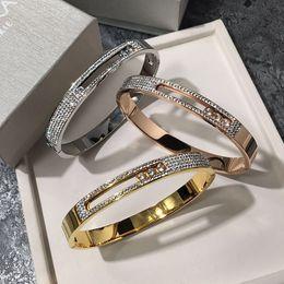 Joyas de moda de lujo barro blanco brazalete de diamantes pulsera de acero de titanio chapado 18K oro rosa hebilla móvil pulsera de tres diamantes desde fabricantes