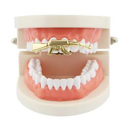 Ak47 gold on-line-HipHop Ak-47 Grillz Topo Grill Duplo Cap Dentes Cor de Ouro Arma de Dente Ak47 Forma Removível Grills Top Teeth