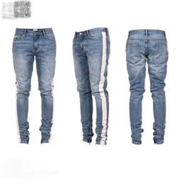 Белые сшитые джинсы онлайн-2018 новый топ лучшая версия Джастин Бибер мужчины джинсы хип-хоп белая полоса шить нижняя сторона молния Жан брюки 28-36