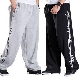 Pantaloni di jersey baggy online-Pantaloni da uomo in jersey di grandi dimensioni hip hop jogging invernale Pantaloni da uomo in felpa casual ampi pantaloni a fasce larghi di Harem Street Dance