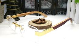 caixa de caixa óptica Desconto Chegada nova marca óculos de sol para mulheres dos homens búfalo chifre óculos sem aro designer de madeira de bambu armações de óculos ópticos com caixa caso lunettes