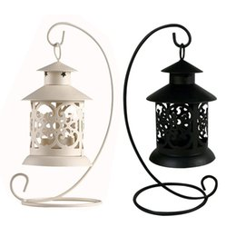 wholesale iron candle holder Coupons - European Style Iron Hollow Candlestick Candle Holder Stand Light Lantern Decor Wedding Home Table Decoration Black White