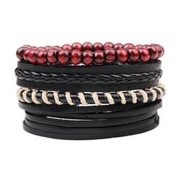Pulsera ajustable hombre cuero negro online-4 unids / set Boho Gypsy Hippie Punk Negro Cuero Beige Cord Wrap Nudos Red Beads de madera pulseras ajustables Set para hombre