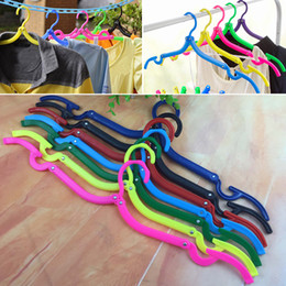 Wholesale magic hangers - New Multifunctional Hangers Space Saver Travel Portable Folding Hanger Rack Outdoor Clothes Hangers Magic Plastic Antiskid Racks WX9-612