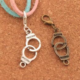 Freiheitszauber online-100 teile / los Handschellen Freiheit Hummer Klaue Verschluss Charme Perlen 45,6x10,2mm Tibetischen silber / Bronze Schmuck DIY C243