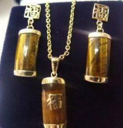 Boucles d'oreilles de collier oeil de tigre exquise ensemble regarder en gros cristal de quartz CZ pierre ? partir de fabricateur