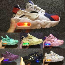Zapatillas de deporte intermitentes online-Nike Air Huarache Flash iluminado Kids Air Huarache Run Shoes Niños zapatos para correr Infantil huaraches niño al aire libre niño atlético niñas zapatilla de deporte