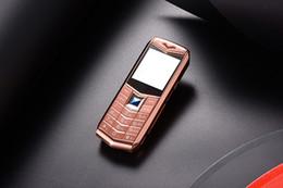 "Wholesale qwerty phones pink - Luxury unlocked dual sim card Mobile Phone 1.5"" MP3 Camera bluetooth Flashlight metal body cheap fashion Golden cellphone phone"