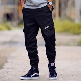 брендовые брюки Скидка High Street Fashion Men's Jeans Casual Jogger Pants Big Pocket Cargo Pants Men Brand Classical Hip Hop Army Big Size 28-40