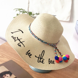 4a0765ed322 2018 summer beach Raffia Sun Hats floppy wide brim straw hat Caps Letter  Embroidery Ribbon Lace Up Outdoor Caps shade hat white