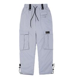 Pantaloni sportivi Hip Hop Uomo Donna Autunno Multi Tasche Pantaloni cargo argento arancioni Uomo Streetwear Pantaloni elastici Pantaloni casual da jogging da