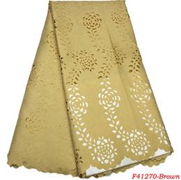 Telas de encaje nigeriano para la boda 2018 El más nuevo diseño Color liso Moda Africana Tela de encaje Láser corte caliente Tulle tela de encaje F4-1270 desde fabricantes