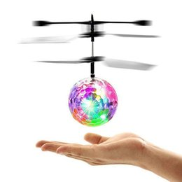 Wholesale flying rc toys - RC Drone Flying Ball Aircraft Helicopter Led Flashing Light Up Toys Induction Electric Toy Drone For Kids Children Christmas gifts