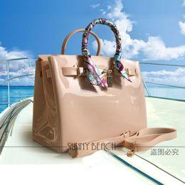 Venta caliente Bolsas de mujer de lujo Bolsa de hombro Bolsas de jalea Bolsa de playa impermeable de PVC bolsa de asas desde fabricantes
