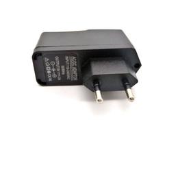 10 шт. лот универсальный зарядное устройство адаптер питания AC 100-240 В DC 5 В 2A USB питания ЕС США Plug для планшетных ПК не для телефонов Бесплатная доставка cheap shipping phone от Поставщики мобильный телефон