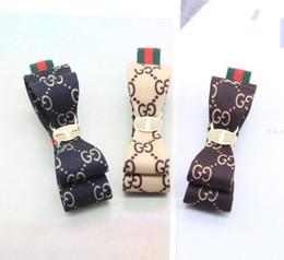Vintage Fashion Handmade Bowknot Barrette Lettere Marchio Logo Morsetti Dei Capelli Clip 3 Colori Anatra Clip Per Le Donne Ragazza Fascino Gioielli Accessori da clip di capelli di marca fornitori