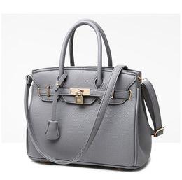 180ca6d6e71f Chinese Vogue Star Luxury Lock Rivet Ladies Leather Tote Bag New Designer  Handbags High Quality Women