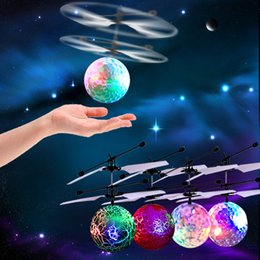 Wholesale Helicopter Toys For Kids - Newly Sensor Aircraft Baby LED Flying Toy Ball Novelty Toys RC Levitated Intelligent Drone Helicopter Ball LED Lighting For Kids Gift