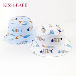 Nuevo 2018 Spring Baby Boys sombreros de copa AB lado 100% algodón Sunhats  para bebés niñas niños al aire libre de dibujos animados lindo Fish Cap 11ecb1dcb15